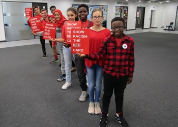 Students wear red to Show Racism The Red Card